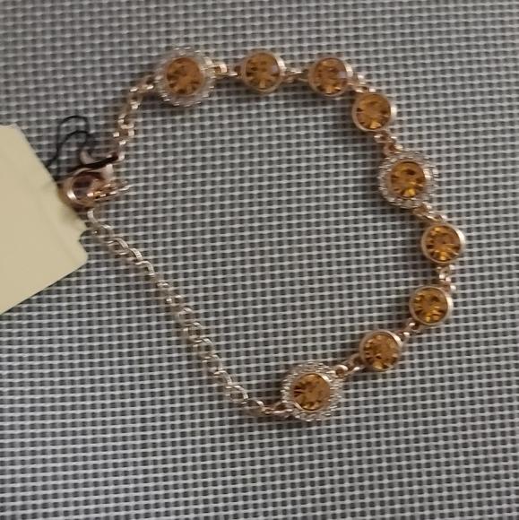 Monet crystal lobster clasp gold tone  bracelet